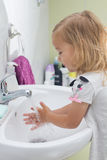 Little girl washing hands Stock Photo