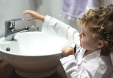 Little girl washing her face Stock Image