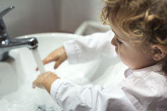 Little girl washing her hands Royalty Free Stock Photos