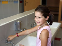 Little girl is washing her hands Stock Photography