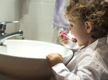 Little girl washing teeth Stock Photography