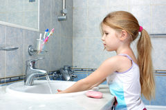 Little Girl Washing With Soap Stock Photography