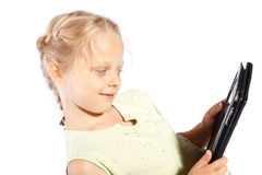 Little girl watches movies on digital tablet Stock Photo