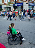 Parade watcher in wheelchair Stock Photo
