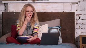 Little girl watching cartoons on laptop. stock footage