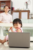 Little girl watching laptop Royalty Free Stock Images