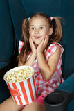 Little girl watching movie at the cinema Stock Photography