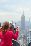 Little girl watching New York Empire State Building Royalty Free Stock Photos