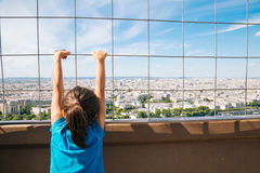 Little girl watching Paris from the Eiffel Tower Royalty Free Stock Photo