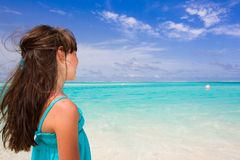 Little girl watching the sea Stock Photo