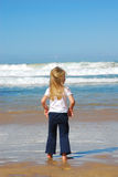 Little girl watching sea Stock Photography