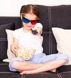 Little girl watching TV. At home Stock Image