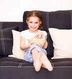 Little girl watching TV. Cute little girl watching TV Stock Photo