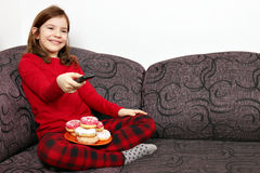 Little girl watching tv Royalty Free Stock Images