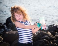 Little girl with water bottle Stock Images
