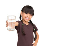 Little girl with a water glass Royalty Free Stock Image