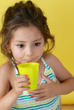 Little girl with a water glass Royalty Free Stock Images