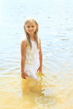 Little girl in water Stock Image
