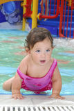 Little girl in the water park at the pool. Stock Images