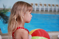 Little girl in the water pool Stock Photo
