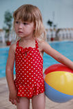 Little girl in the water pool Stock Photos