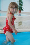Little girl in the water pool Royalty Free Stock Image