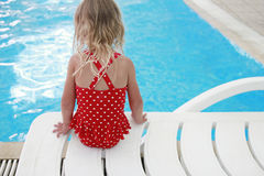 Little girl in water pool Royalty Free Stock Photos