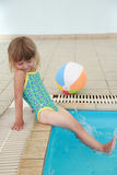Little girl in the water pool Stock Photography