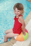 Little girl in the water pool with a ball Royalty Free Stock Image