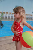 Little girl in the water pool Stock Images