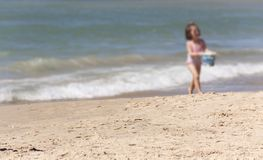 Little girl at the water`s edge as background royalty free stock photo
