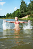 Little girl in water and spray Royalty Free Stock Photography