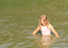 Little girl in water Stock Photos