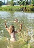 Little girl in water Stock Photography