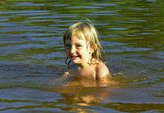 Little girl in water on sunny day Stock Photography