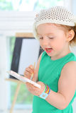 Little girl with watercolor paints in hands Royalty Free Stock Image