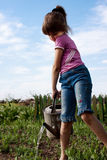 Little girl with watering can Royalty Free Stock Photo