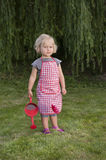Little girl with watering can in the garden Royalty Free Stock Images