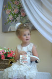 Little girl with a watering can in  hand Royalty Free Stock Photo