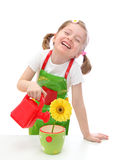 Little girl watering a  daisy Stock Photo