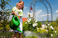 Free Little Girl Watering Flowers Stock Photo - 12746430