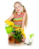 Little girl watering flowers Royalty Free Stock Image