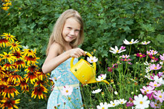 Little girl watering flowers Royalty Free Stock Photography