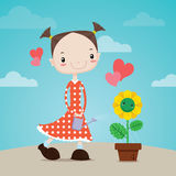 The Little girl watering flowers to plant Stock Photos