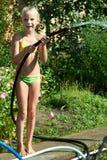 Little girl watering the garden Stock Image