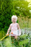 Little girl watering the grass Royalty Free Stock Photos