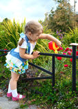 Little girl watering the grass Stock Photo