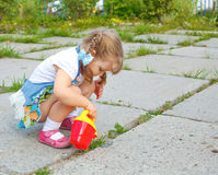 Little girl watering the grass Royalty Free Stock Photo