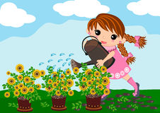 Little girl watering plants Stock Photo