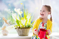 Little girl watering spring flowers Stock Photo